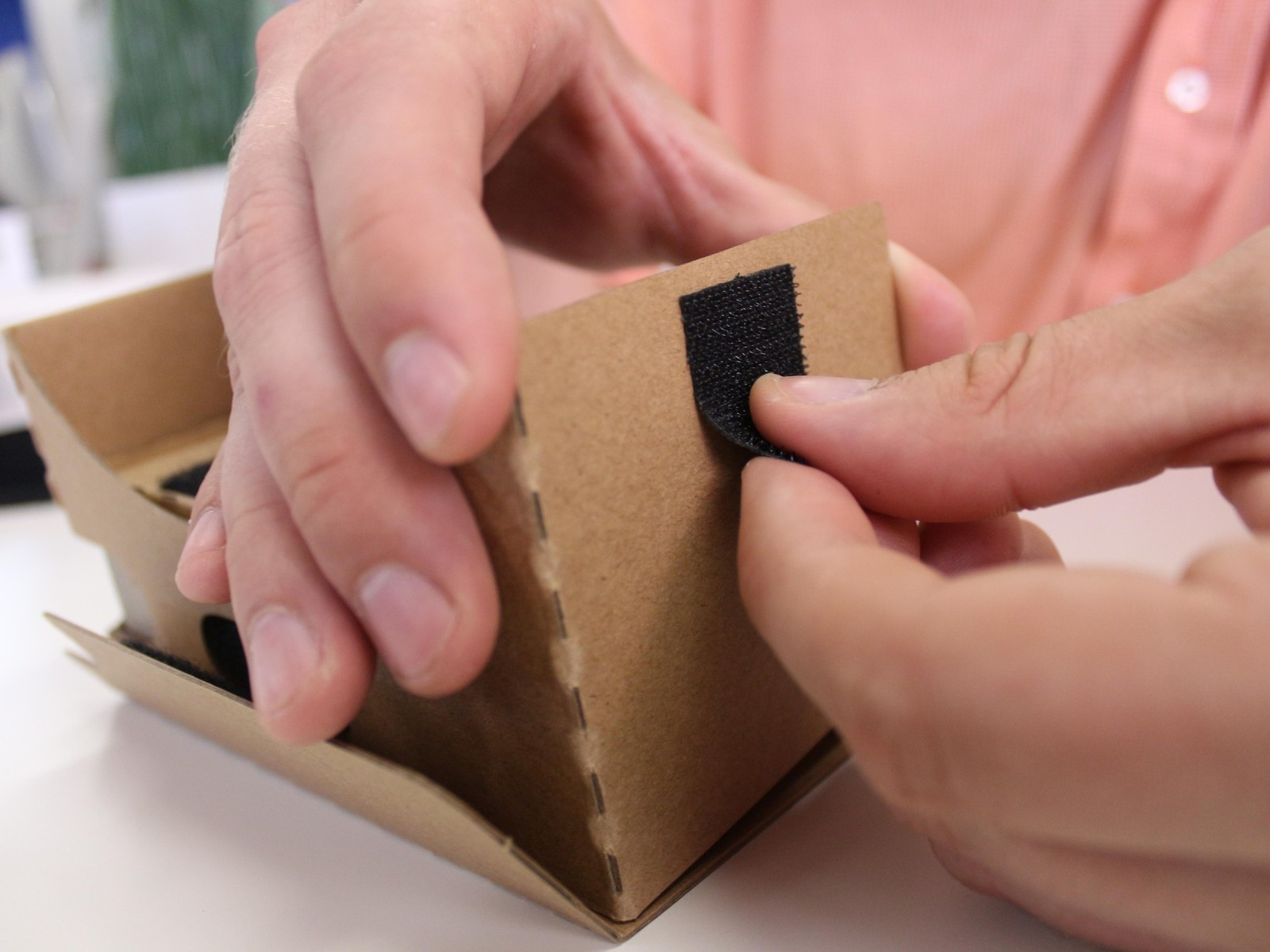 Remove the backing of the first velcro strip and adhere it to the side of the viewer.
