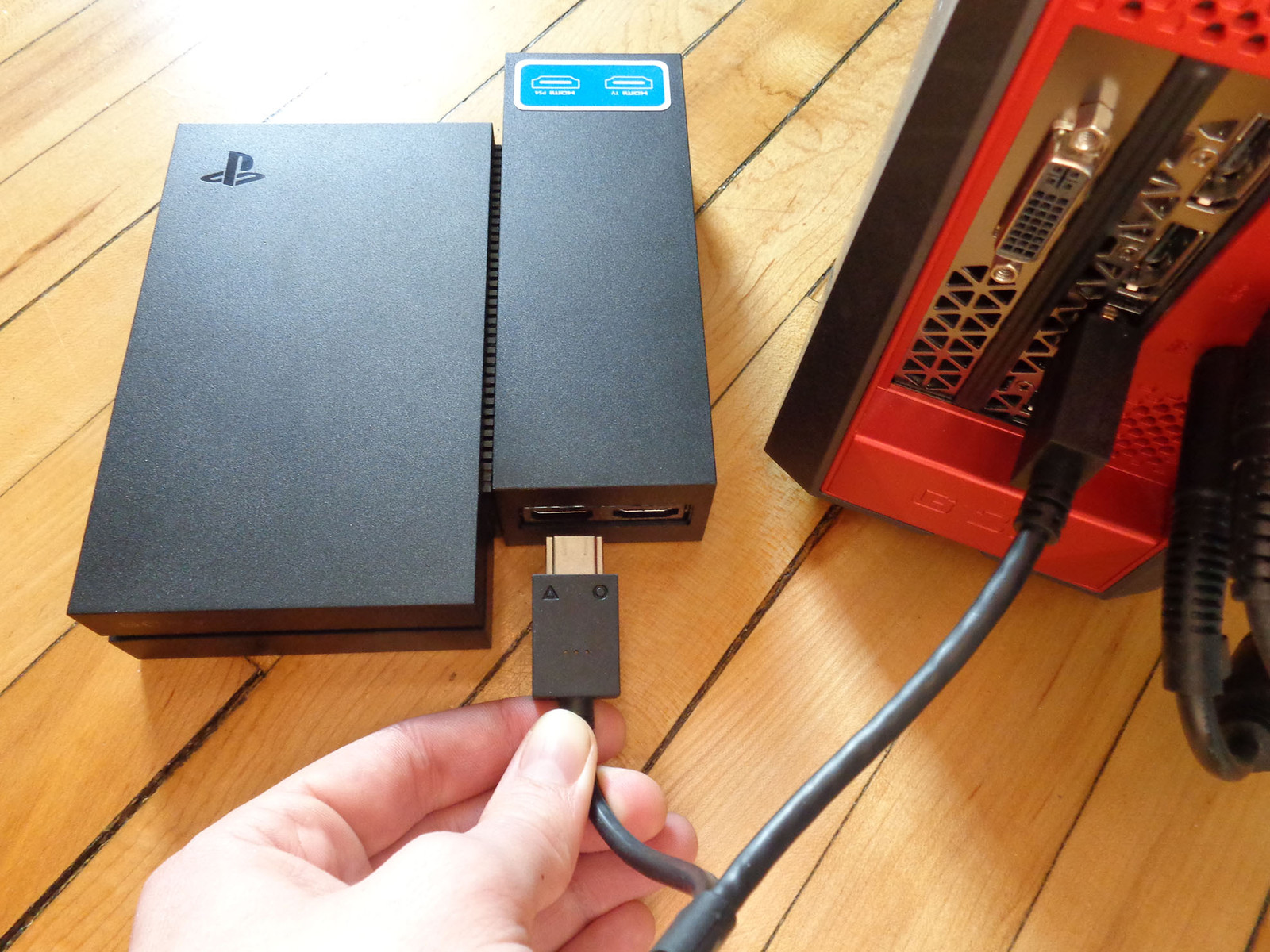 Plug the PSVR power cable into the processing unit.